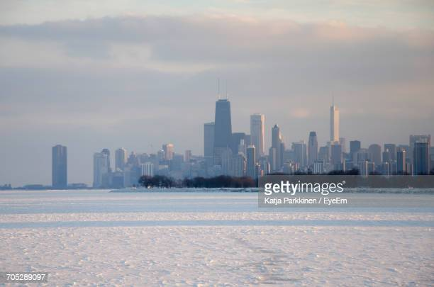 View Of Cityscape Against Sky During Winter