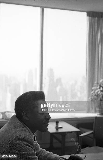 View of Civil Rights leader Bayard Rustin as he sits at a table New York 1964