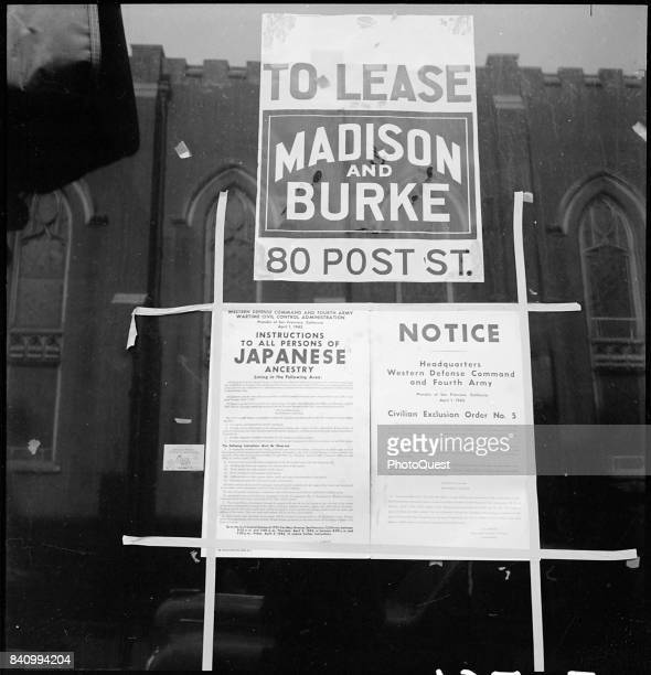 View of 'Civilian Exclusion Order Number 5' which ordered the 'evacuation' of residents of Japanese ancestry posted in a vacant store window on Grant...
