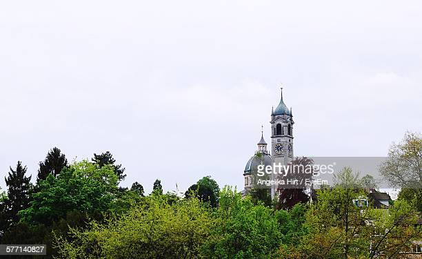 View Of Clock Tower And Dome Behind Trees