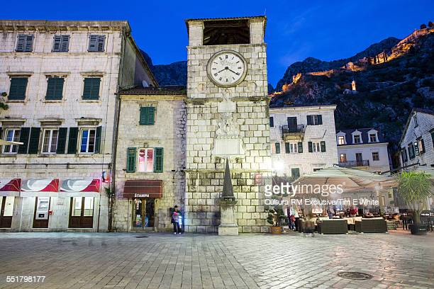 View of clock tower in old town at dusk, Kotor, Montenegro