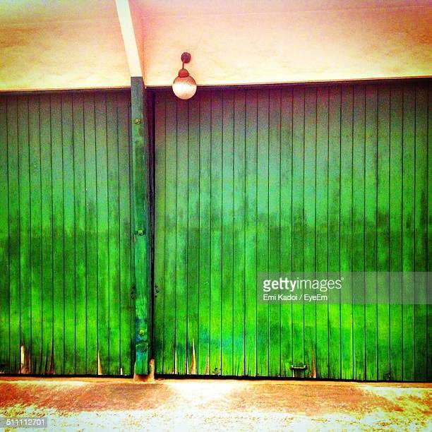 View of closed green shutters