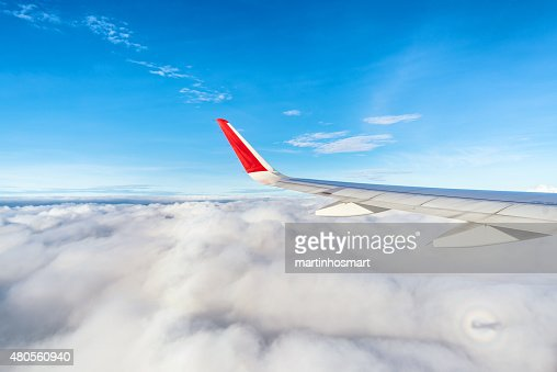 View of clouds from a airplane window : Stock Photo