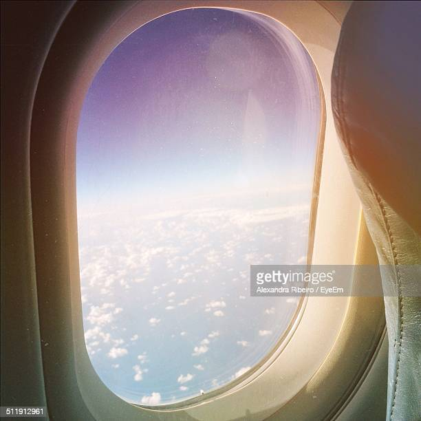 View of clouds through airplane window