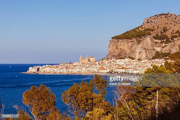View of coastline and Cefalu in Sicily , Italy