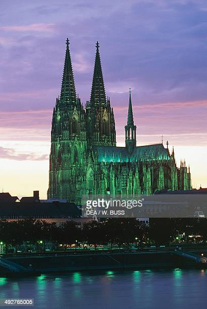 View of Cologne Cathedral at sunset with the Rhine in the foreground Cologne North RhineWestphalia Germany