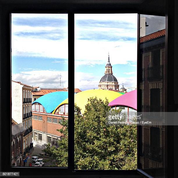 View of colorful domed building through window