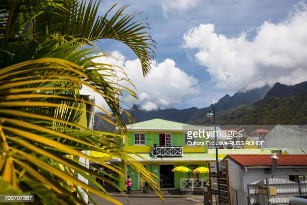 View of colourful village buildings and mountains, Reunion Island