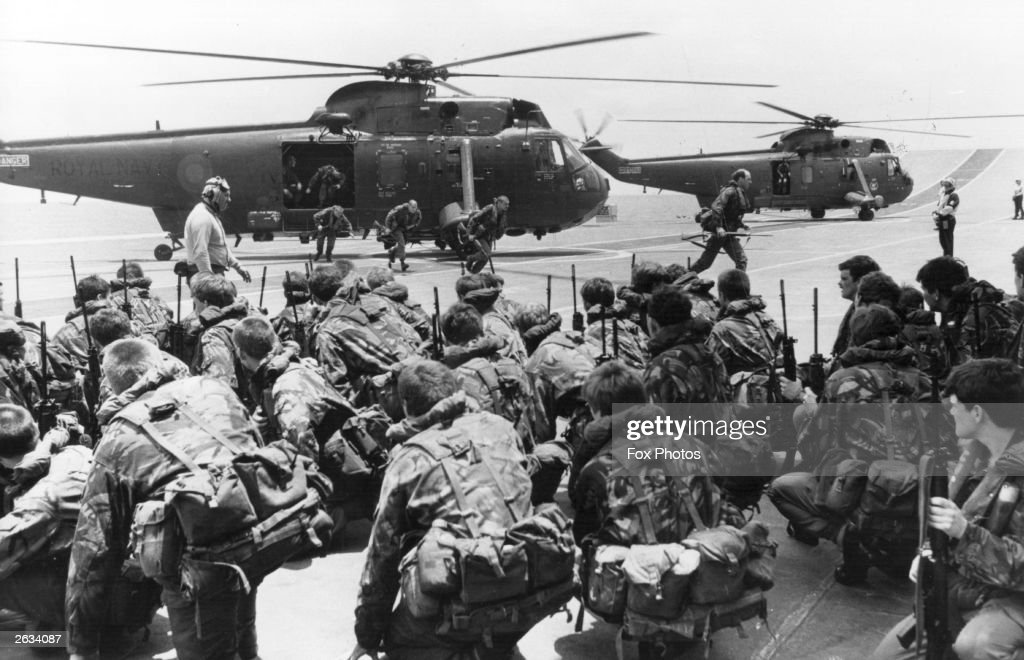A View of commandos being lifted from the decks of HMS Hermes and HMS Invincible to be transferred by Westland Sea King helicopters to other ships...