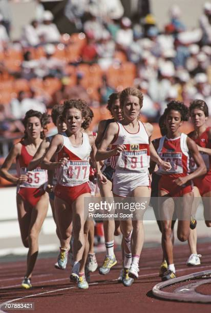 View of competition in the Women's 3000 metres event with Angela Chalmers of Canada on far left Cornelia Burki of Switzerland on 2nd left and Vera...