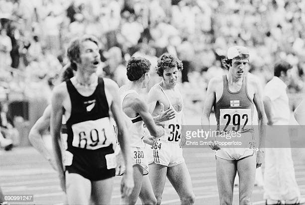 View of competitors after the finish of the final of the Men's 5000 metres event with from left to right silver medallist Dick Quax of New Zealand...