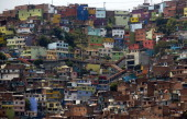 View of Comuna 13 shantytown one of the poorest areas of Medellin Antioquia department Colombia on April 1 ahead of the World Urban Forum 7 which...