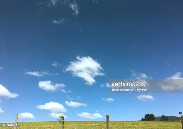 View Of Countryside Landscape Against Blue Sky