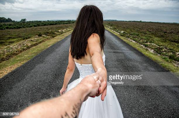 View of couple on long road