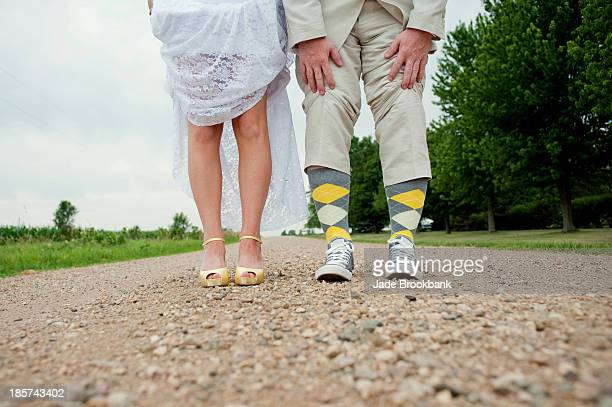 View of couples legs on wedding day