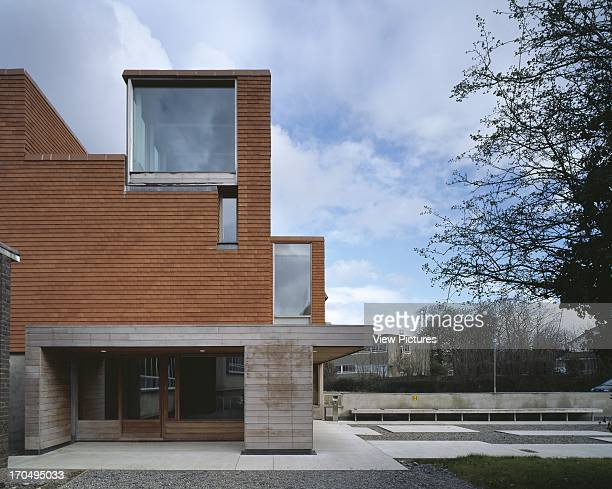 View of covered entrance showing landscaped space low wall with seating roof light and timber detailing Urban Institute of Ireland Dublin Ireland...
