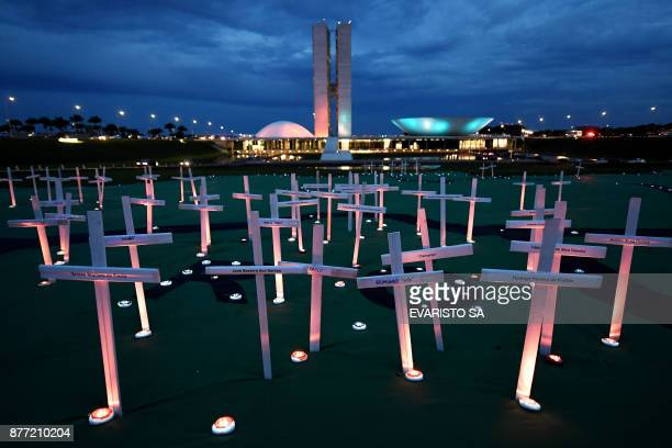 View of crosses set up by Greenpeace activists to protest against deaths caused by illegal logging in the Brazilian Rain Forest in front of the...