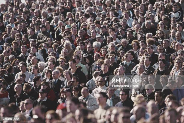 View of crowds of punters and racegoers watching the action on Grand National Day during the 2002 Martell Grand National Meeting at Aintree Race...