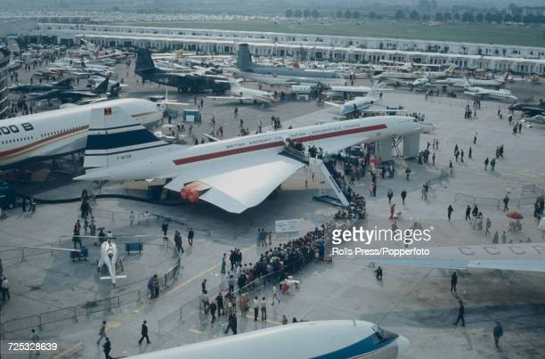 View of crowds queuing to tour the French built AngloFrench Concorde 001 FWTSS prototype supersonic aircraft on static display at Le Bourget Airport...