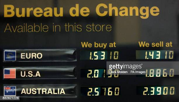 View of currency exchange rates displayed on an electronic board outside Marks and Spencer supermarket on Kensington High Street in London
