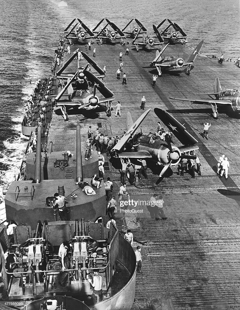 View of Curtiss Helldivers on the deck of a US aircraft carrier west of Philippines Pacific Ocean October 25 1944 In the foreground is a 40 mm...