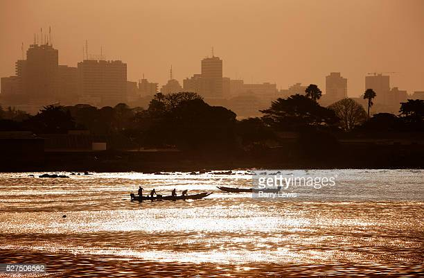 View of Dakar from the sea at dawn with fishing boats in the foreground Dakar is the capital city and largest city of Senegal It is located on the...