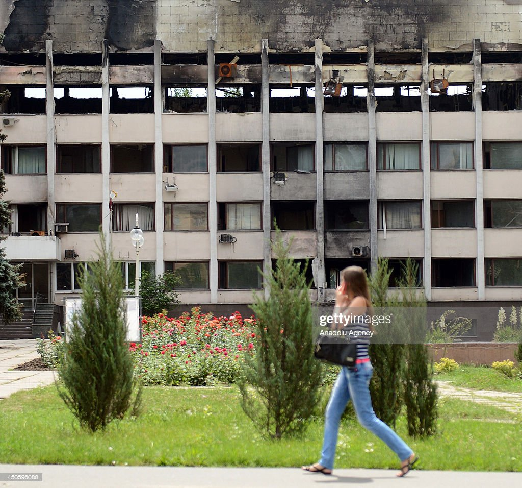 A view of damaged building that destroyed during the clash between Ukraine army and pro-Russian separatists in Mariupol, Ukraine on 14 June, 2014. Ukrainian troops seized the main checkpoints of the city in the early hours of Friday.