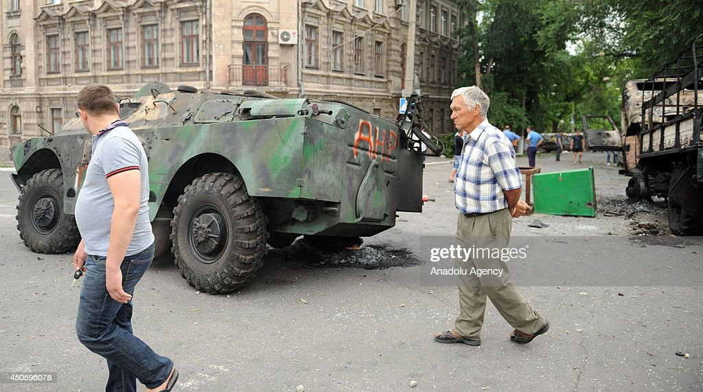 A view of damaged tank that destroyed during the clash between Ukraine army and pro-Russian separatists in Mariupol, Ukraine on 14 June, 2014. Ukrainian troops seized the main checkpoints of the city in the early hours of Friday.