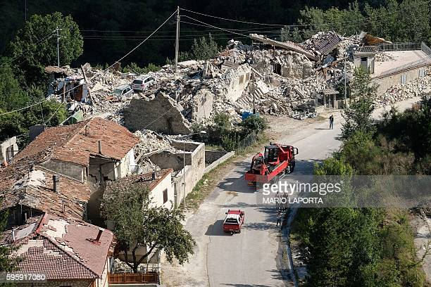 TOPSHOT View of damages in a street of Pescara del Tronto a central Italian village near Amatrice on August 26 two day after a 62magnitude earthquake...