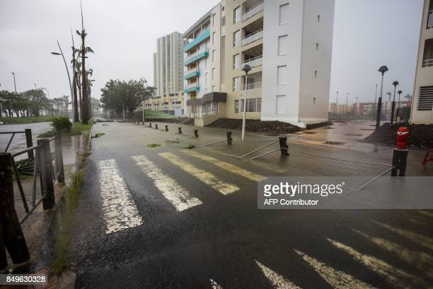 A view of damages on Boulevard Chanzy in downtown PointeaPitre on September 19 2017 in the French territory of Guadeloupe after the passage of...