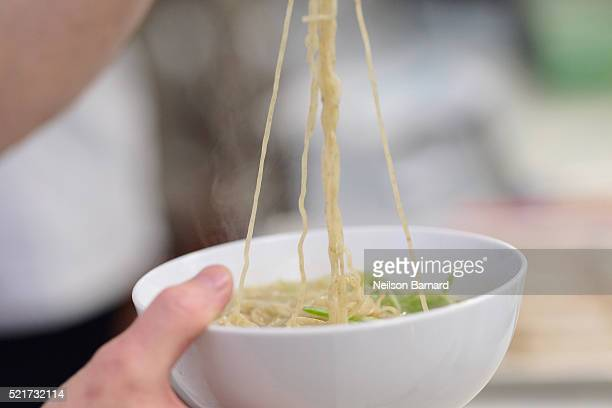 View of dashi finishing fat Katsuobushi salt shio tare ramen finished dish during Chef Ivan Orkin's The Secret to Ramen class at The 8th Annual New...