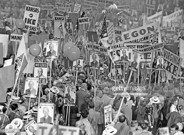 View of delegates at the Republican National Convention many of whom carry banners that support Dwight David Eisenhower as their candidate for US...