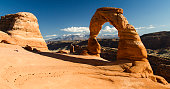 View of Delicate Arch with the La Sal mountain range in the background, Arches National Park, Utah.