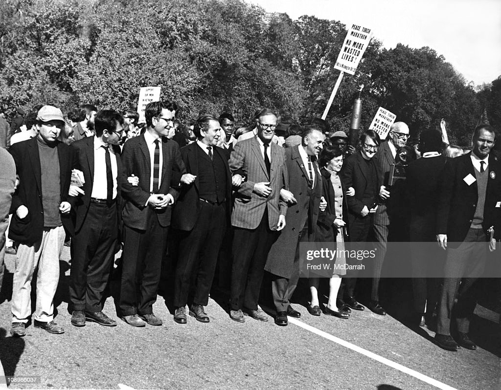 View of demonstrators during the 'March on the Pentagon,' Washington DC, October 21, 1967. Among those pictured are, from left, Marcus Raskin, <a gi-track='captionPersonalityLinkClicked' href=/galleries/search?phrase=Noam+Chomsky&family=editorial&specificpeople=635340 ng-click='$event.stopPropagation()'>Noam Chomsky</a>, <a gi-track='captionPersonalityLinkClicked' href=/galleries/search?phrase=Norman+Mailer&family=editorial&specificpeople=206831 ng-click='$event.stopPropagation()'>Norman Mailer</a> (1923 - 2007), Robert Lowell (1917 - 1977), Sidney Lens (1912 - 1986), Dagmar Wilson (1916 - 2011), unknown, and Dr. <a gi-track='captionPersonalityLinkClicked' href=/galleries/search?phrase=Benjamin+Spock&family=editorial&specificpeople=896827 ng-click='$event.stopPropagation()'>Benjamin Spock</a> (1903 - 1998).