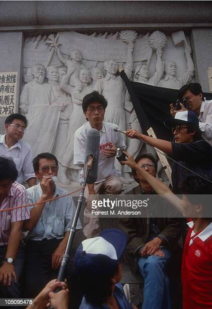 View of demonstrators gathered in Tiananmen Square where singercomposer Hou Dejian speaks also seen are literary critic Liu Xiaobo and sociologist...