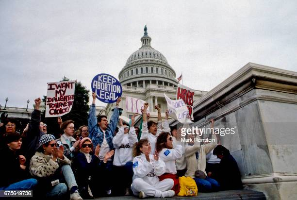 View of demonstrators many with signs during the March for Women's Lives Washington DC April 9 1989 Among the visible signs are ones that read 'I...