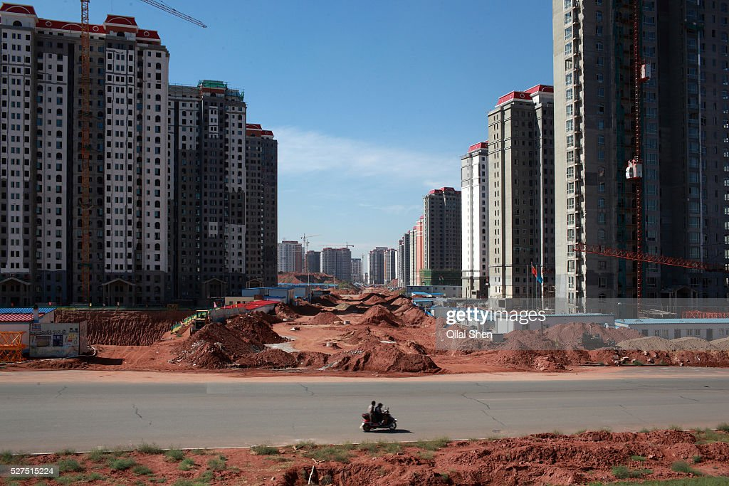 A view of densely built residential apartment developments near the Kangbashi New District of Ordos City Inner Mongolia China on 16 August 2011 With...