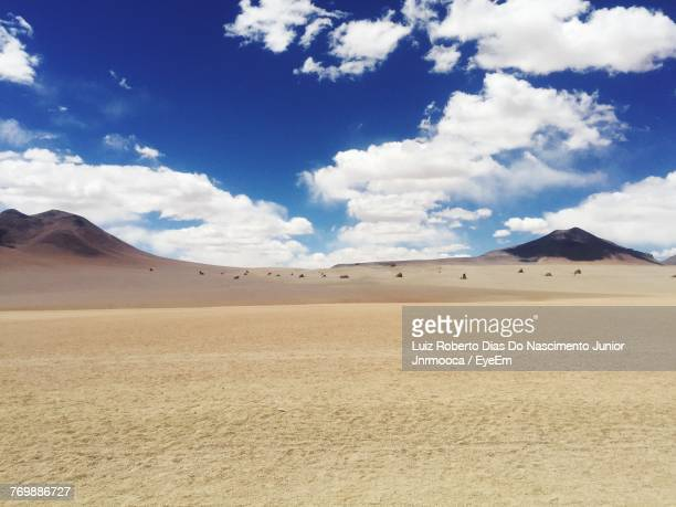 View Of Desert Against Cloudy Sky