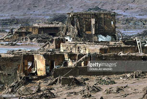 View of destroyed houses after a dam burst in the village of Bento Rodrigues in Mariana Minas Gerais state Brazil on November 6 2015 A dam burst at a...