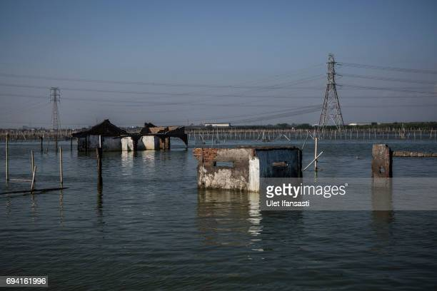 A view of destroyed houses caused from rising sea level at Sriwulan village on June 8 2017 in Demak Indonesia Indonesia is known to be one of the...