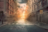 View of destruction city with fires and explosion over dramatic sky background