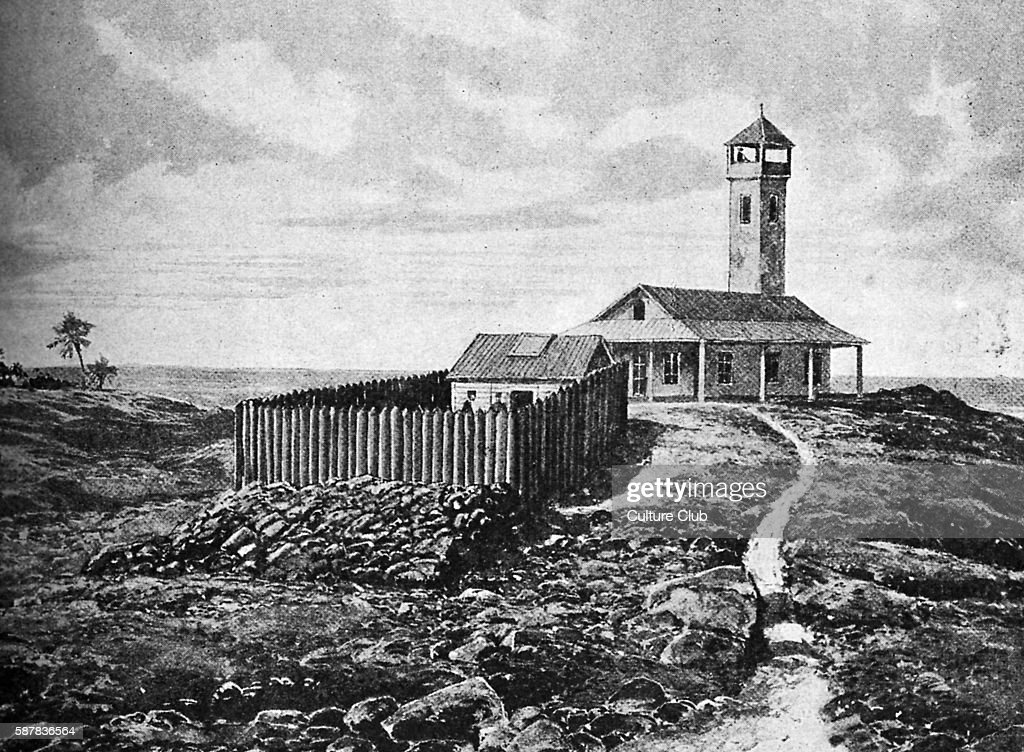 View of Devils island showing the prison hut inside the enclosure of palisades with the governors house in the background Falsely imprisoned 189599...
