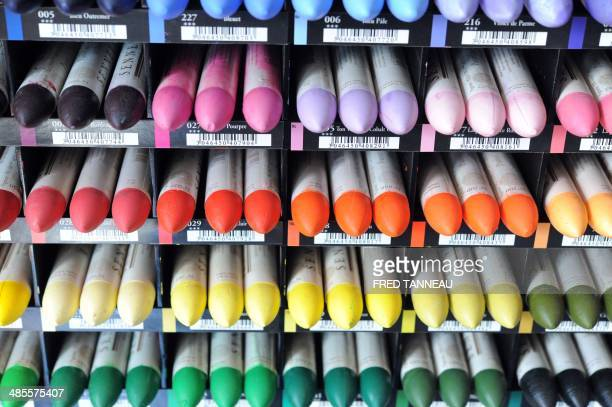 A view of different pastel crayons in a workshop at the RaphaelIsabeySennelier factory in SaintBrieuc western France on April 18 2014 AFP PHOTO /...