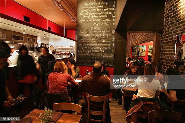 View of dining room and the kitchen on the left at Cannelé – a new restaurant in Atwater Village Chef Corina Weibel's cooking keeps the neighborhood...