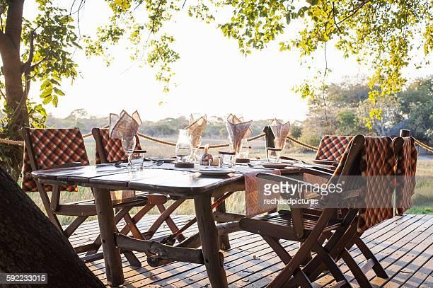 View of dining table at safari lodge, Kafue National Park, Zambia