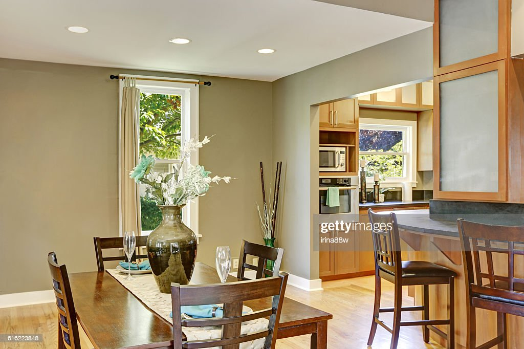 View of dining table set and bar stools : Stock Photo