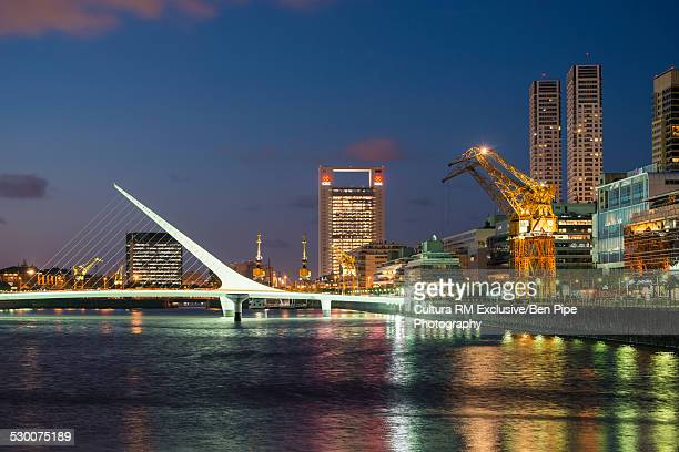 View of docks and Puente de la Mujer footbridge at night, Puerto Madero, Buenos Aires, Argentina