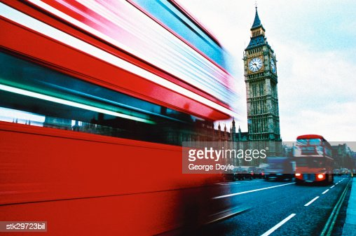 view of double decker busses driving past big ben : Stock Photo