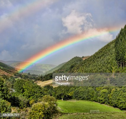 View of double rainbow above valley