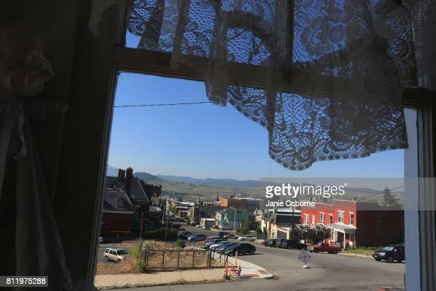A view of downtown is seen through a Butte resident's window on July 6 2017 in Butte Montana Butte is home to the toxic Berkeley Pit Formerly an open...